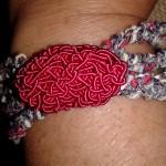 Braccialetto tessuto rosso